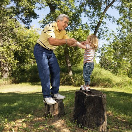 Senior man and child playing.
