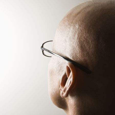 backview: Backview of mid-adult Caucasian males head. Stock Photo