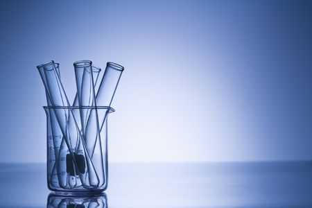 sciences: Test tubes in glass beaker with blue tint.
