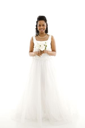 Mid-adult African-American bride holding bouquet on white background. Stock Photo - 1858819