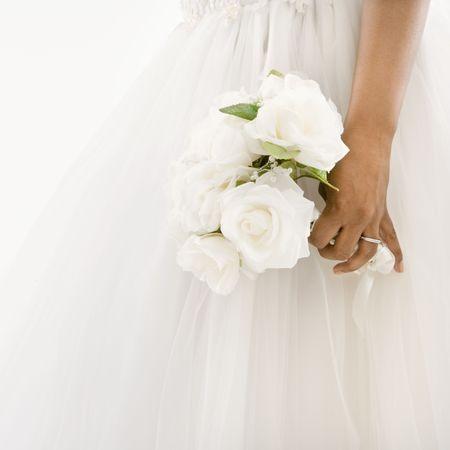 African-American bride holding bouquet.
