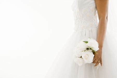 African-American bride holding bouquet. Stock Photo - 1858824