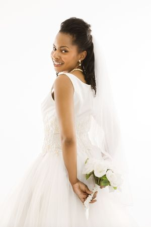 Portrait of a mid-adult African-American bride holding bouquet. Stock Photo - 1858853