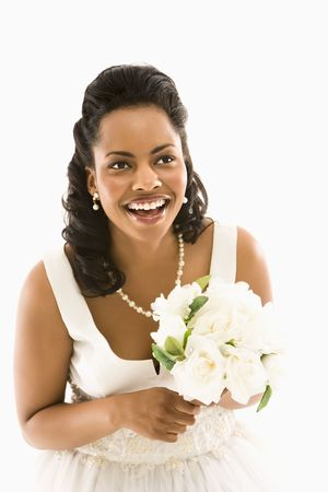 Portrait of a mid-adult African-American bride holding bouquet. Stock Photo - 1858875