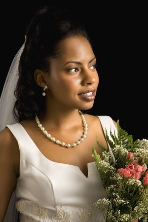 Portrait of a mid-adult African-American bride on black background. Stock Photo - 1859098
