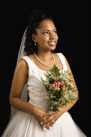 Portrait of a mid-adult African-American bride on black background. Stock Photo - 1859022