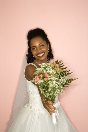 Portrait of a mid-adult African-American bride on pink background. Stock Photo - 1859043