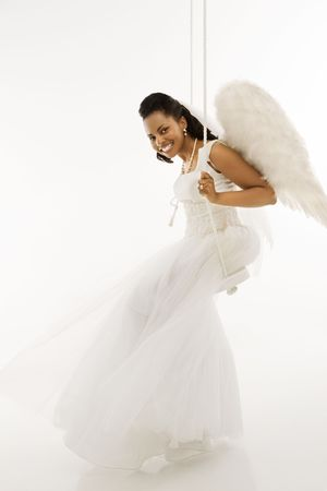 Angelic Mid-adult African-American bride swinging.  Stock Photo - 1858821