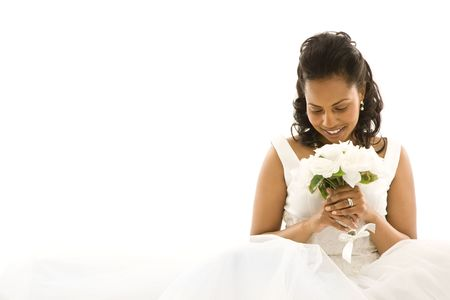 Mid-adult African-American bride on white background. Stock Photo - 1858842