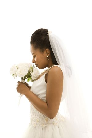 Mid-adult African-American bride on white background. Stock Photo - 1858899