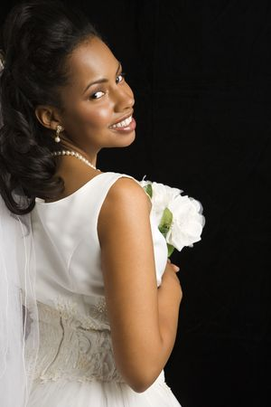 Portrait of a mid-adult African-American bride on black background. Stock Photo - 1859084