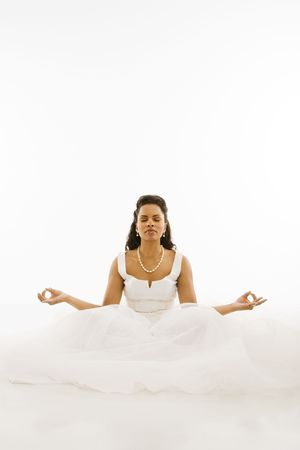 Mid-adult African-American bride mediating with white background. Stock Photo - 1858811