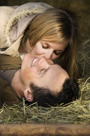 Couple in hay. photo