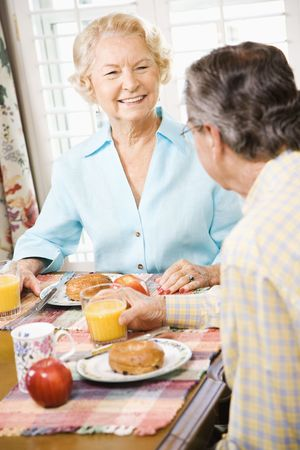 Mature Caucasian couple having breakfast together. photo