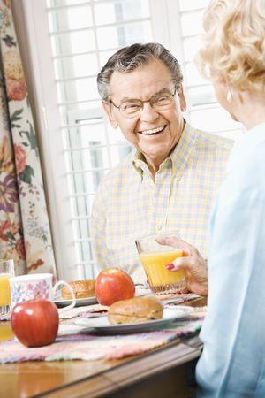 Mature Caucasian couple having breakfast together. photo