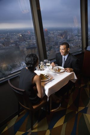 African-American couple having dinner at the Tower of the Americas in San Antonio, Texas. photo