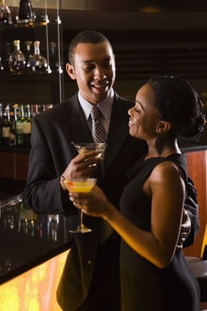 africanamerican: African-American couple having drinks at the bar. Stock Photo
