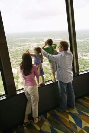 Caucasian family looking out observation deck at Tower of the Americas in San Antonio, Texas. Stock Photo - 1869002