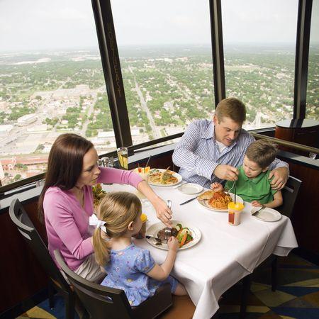 americas: Caucasian family having dinner together at Tower of Americas restaurant in San Antonio, Texas.