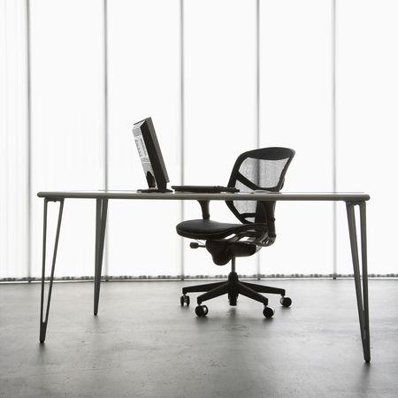 Still life shot of computer monitor and keyboard with office chair. Stock Photo - 1868935