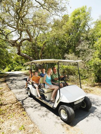 golf cart: Caucasian  riding on golf cart on trail in North Carolina, USA.