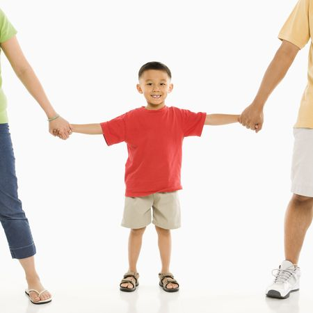 Asian parents holding hands with son in front of white background. Stock Photo - 1868849