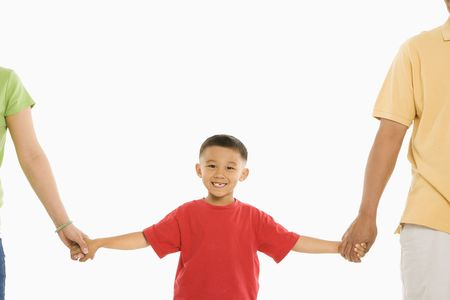 Asian parents holding hands with son in front of white background. Stock Photo - 1868847