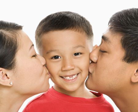 filipino people: Parents kissing son.