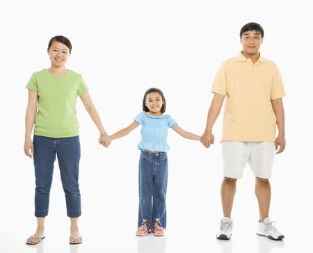 Asian parents holding hands with daughter in front of white background. Stock Photo - 1868886