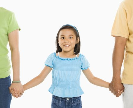 Asian girl holding hands with mother and father in front of white background. Stock Photo - 1868950