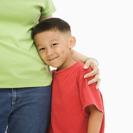 Asian mother standing with arm around son. Stock Photo - 1869003