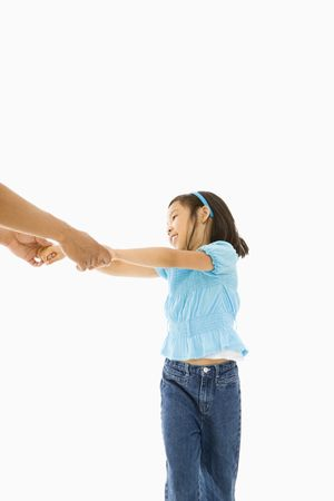Asian girl playing and holding hands with father. Stock Photo - 1868840