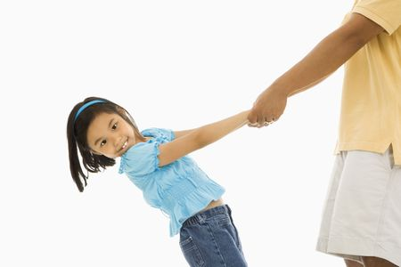 Asian girl holding father's hands and leaning back. Stock Photo - 1868882