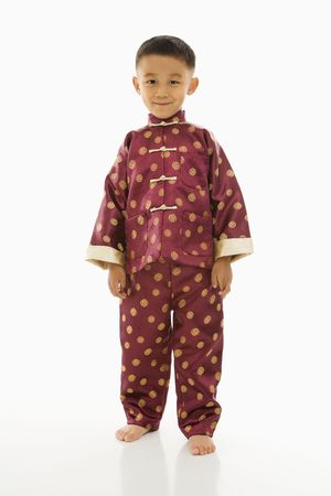 formal wear clothing: Asian boy standing against white background in traditional  attire.