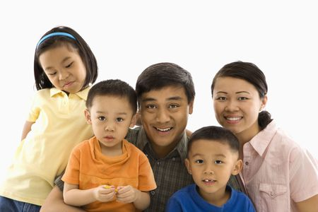 Asian family portrait against white background. photo