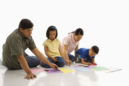 Asian parents sitting on floor with children coloring. Stock Photo - 1868905