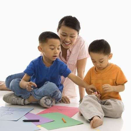 Asian mother with boys coloring. photo
