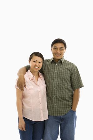 eachother: Asian man and woman standing with arms around eachother.