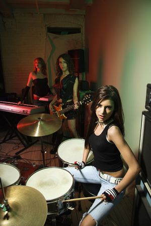 snare drum: Caucasian girl band with their instruments.