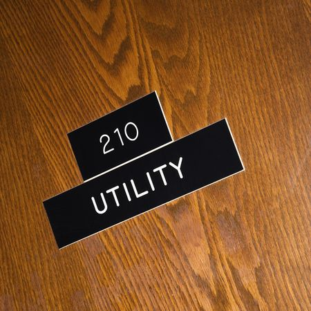 Shot of utility sign on wooden door. photo