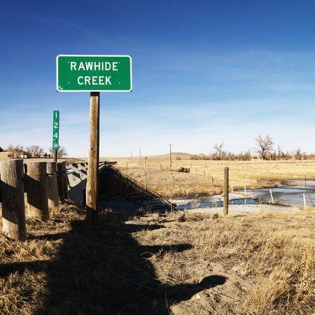rawhide: Rawhide creek sign in rural landscape.
