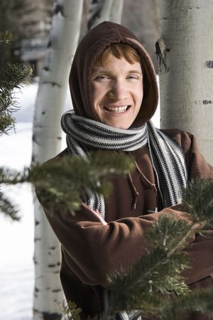 Portrait of a Caucasian male teenager wearing hoodie and scarf in winter setting. Stock Photo - 1874657