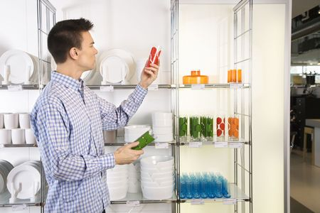 Asian male shopping for dishes and glasses in retail store. Stock Photo - 1874653