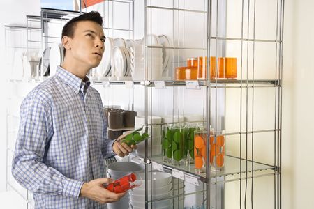 Asian male shopping for dishes and glasses in retail store. Stock Photo - 1874701