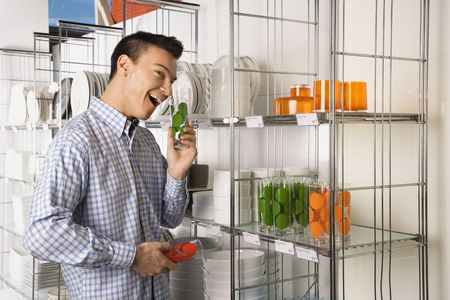 Asian male shopping for dishes and glasses in retail store. Stock Photo - 1874731