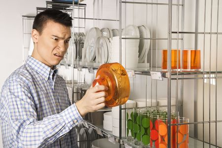 Asian male shopping for dishes and glasses in retail store. Stock Photo - 1874724