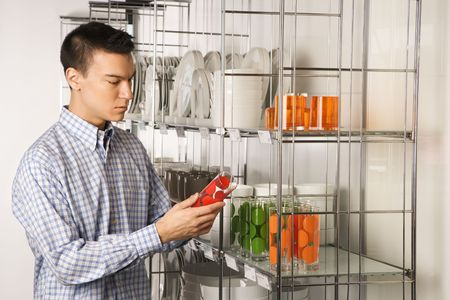Asian male shopping for dishes and glasses in retail store. Stock Photo - 1874703