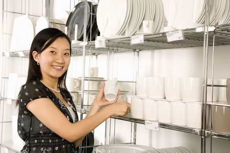 Asian female shopping for dishes and glasses in retail store. Stock Photo - 1874620
