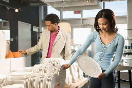African American couple shopping in a home furnishings retail store.  Stock Photo - 1874610
