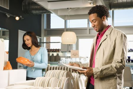 furnishings: African American couple shopping in a home furnishings retail store.